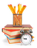 Books, an alarm clock and school tools. Royalty Free Stock Photo
