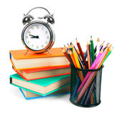 Books, an alarm clock and school tools. Royalty Free Stock Photos