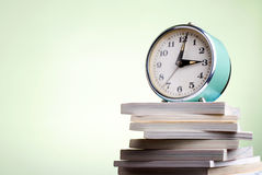 Books and an alarm clock Stock Images
