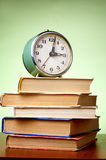 Books and an alarm clock Royalty Free Stock Image