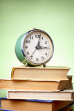 Books and an alarm clock Royalty Free Stock Photography