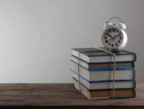 Books with alarm clock Royalty Free Stock Images