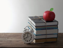 Books with alarm and red Apple Stock Images
