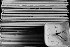 The books and the allarm clock in black and white Stock Photography