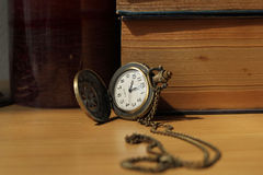 Books on antique clocks. On the desk in vintage style Stock Images