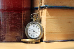 Books on antique clocks. On the desk in vintage style Stock Photos