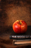 Books and apple. Close up of red apple and Books stock photos