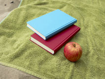Books and apple Stock Photos