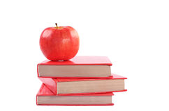 Books with apple. On white background Stock Photos