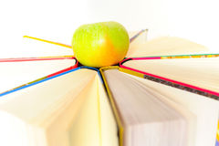 Books and apple. Circle of books and a green apple royalty free stock image