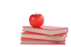 Books with apple. On white background Stock Photography