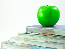 Books and an apple Stock Photos
