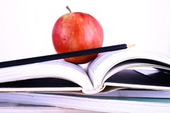 Books and apple stock image