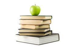 Books with apple. Green apple on books. Isolated on white Royalty Free Stock Photography