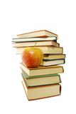 Books and apple. A group of books and one apple on the white background stock image
