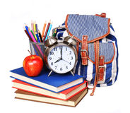 Books, apple, backpack, alarm clock and pencils isolated Stock Photos
