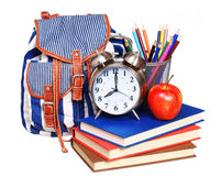 Books, apple, backpack, alarm clock and pencils isolated Royalty Free Stock Image