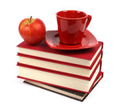 Books with apple and coffee cup Stock Images
