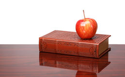 Books and apple on the desk, isolated Royalty Free Stock Photo