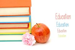 Books, apple and flower Royalty Free Stock Photography