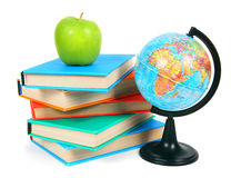Books, an apple and globe. On white background. Stock Photography