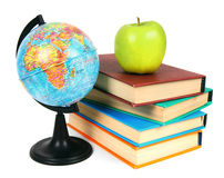 Books, an apple and globe. On white background. Stock Photo