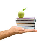 Books with apple in hand. As a gift of education stock photos