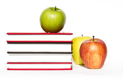Books and apple isolated on white background Royalty Free Stock Images