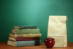 Books, Apple and Lunch on Teacher Desk Stock Photography