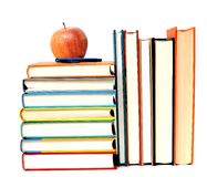 Books, apple and pen Stock Images