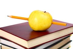 Books are an apple and pencil Royalty Free Stock Images