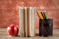 Books,apple and pencil cup Stock Image