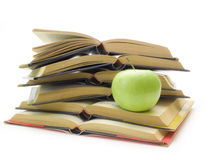 Books and apple on white background Stock Photos
