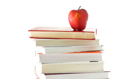 Books and apple on white background Royalty Free Stock Image