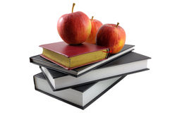 Books and apples. On white background Stock Images