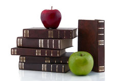 Books with apples Stock Images