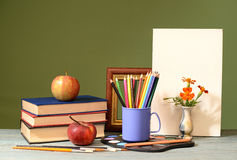 Books, apples, colored pencils and painting canvas Stock Photo
