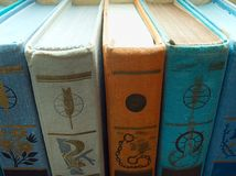Books arranged in a row. The books arranged in a row, macro indoor shot royalty free stock photos