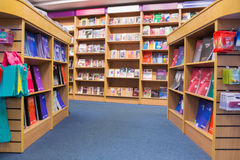 Books arranged in shelf. At library stock photography