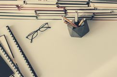 Books background, glasses and textbooks on white wooden table stock images