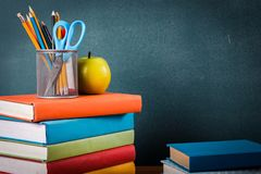 Stack of colorful books on board background. Books background paper art abstract brown apple Stock Photos