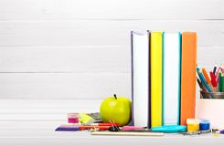 Stack of colorful books on board background. Books background paper art abstract brown apple Royalty Free Stock Images