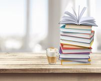 Stack of colorful books on blurred background. Books background paper art abstract brown cup Royalty Free Stock Photography