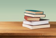 Row of of colorful books on background. Books background paper art abstract brown dark Royalty Free Stock Photos