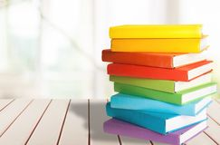Stack of colorful books on wooden table. Books background paper art abstract brown dark Royalty Free Stock Images