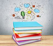 Stack of colorful books on wooden table. Books background paper art abstract brown dark Royalty Free Stock Photos