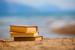 Books on a beach Royalty Free Stock Images