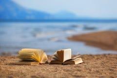Books on a beach Stock Image