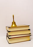 Books and a bell Royalty Free Stock Photos