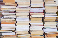 Books. Big pile of books at table in library Stock Photos